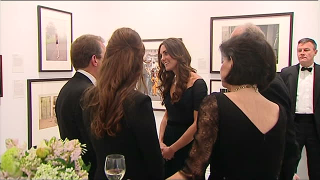 Interior shots zoom out from Nizam of Hyderabad necklace on loan from the Queen to Catherine Duchess of Cambridge wearing the necklace talking with...