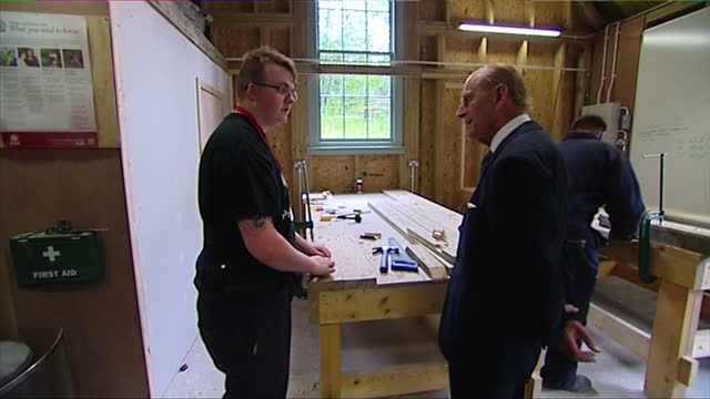 interior showing prince philip duke of edinburgh wood workshop chatting with apprentice carpenter on july 02 2014 in dumfries scotland - verwaltungsbehörde dumfries and galloway stock-videos und b-roll-filmmaterial