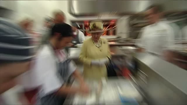 interior showing queen elizabeth accompanied by prince charles in industrial kitchen queen elizabeth smiles and she chats to apprentice chef on july... - verwaltungsbehörde dumfries and galloway stock-videos und b-roll-filmmaterial