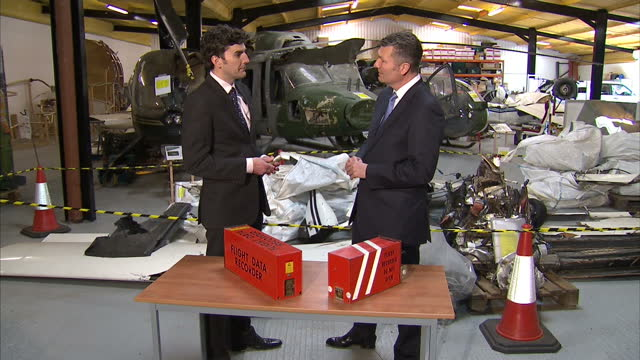 interior shows black box equipment on table in aeroplane wreckage hanger at cranfield university air accident investigation laboratory interview with... - air vehicle stock videos & royalty-free footage