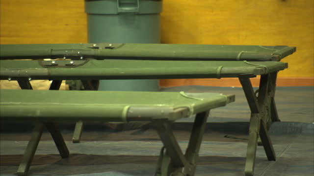 interior shows community centre hall being used as makeshift shelter for displaced people camp beds and blankets out on march 20 2014 in oso... - oso washington stock videos & royalty-free footage