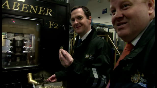 interior shows george osborne at royal mint comparing new and old styles of pound coin on march 20 2014 in pontyclun wales - royal mint stock videos & royalty-free footage