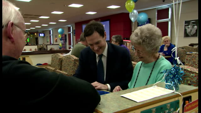 vídeos y material grabado en eventos de stock de interior shows george osborne chancellor of the exchequer playing bingo at table with elderly people on march 20 2014 in cardiff wales - bingo