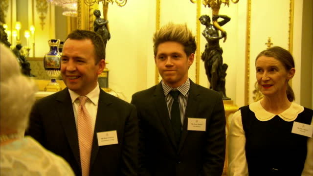 Interior shows Niall Horan singer in One Direction in Buckingham Palace preparing to meet Queen Elizabeth on March 20 2014 in London England