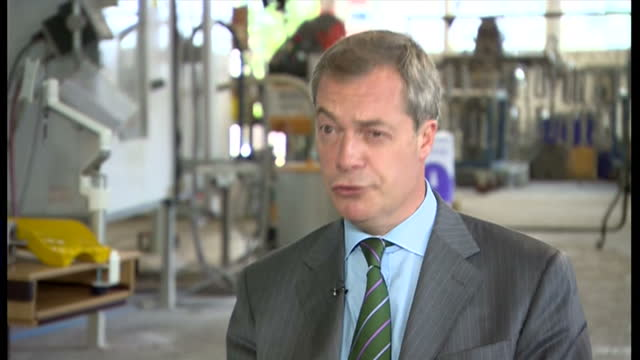 interior shows nigel farage ukip leader sit down interview ukip mep speaks about cost of living and foreign workers at doncaster racecourse on... - mep stock-videos und b-roll-filmmaterial
