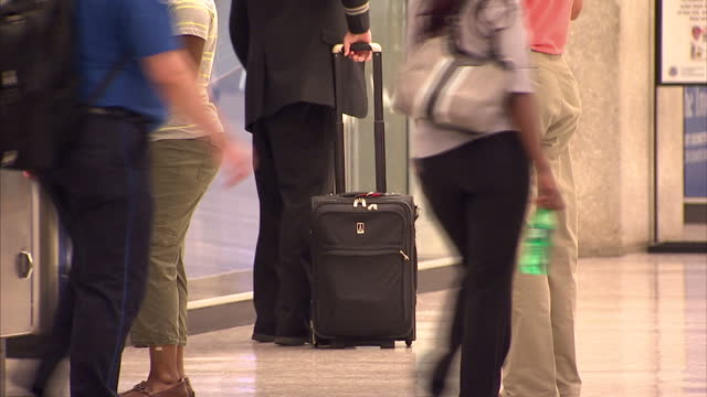 interior shows passengers with baggage waiting in airport other passengers pass at dulles international airport on october 06 2014 in dulles virginia - dulles international airport stock videos and b-roll footage