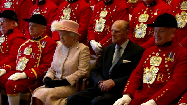 interior shows photo opportunity, queen elizabeth and prince philip pose with royal waterman, three rows, most men in ceremonial dress, queen and... - dress stock videos & royalty-free footage