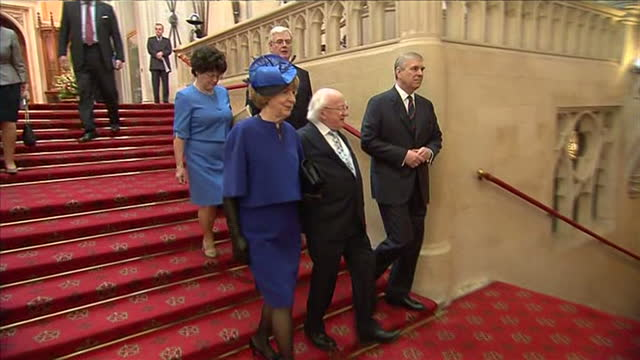 interior shows prince andrew duke of york walking and chatting to michael d higgins in windsor castle - michael d. higgins stock videos and b-roll footage