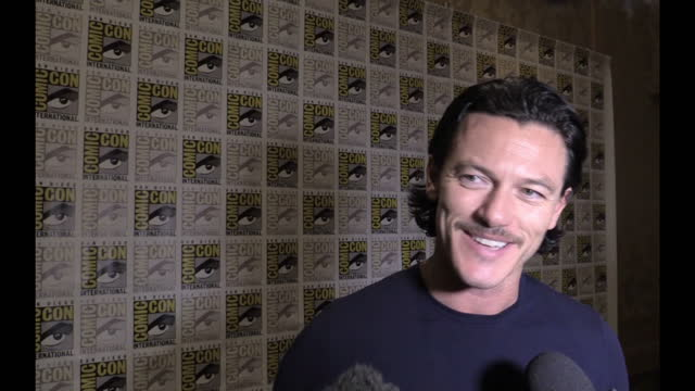 interior soundbite with actor luke evans speaking about how much he enjoys attending and taking part in comiccon>> on july 27 2014 in san diego... - attending stock videos and b-roll footage