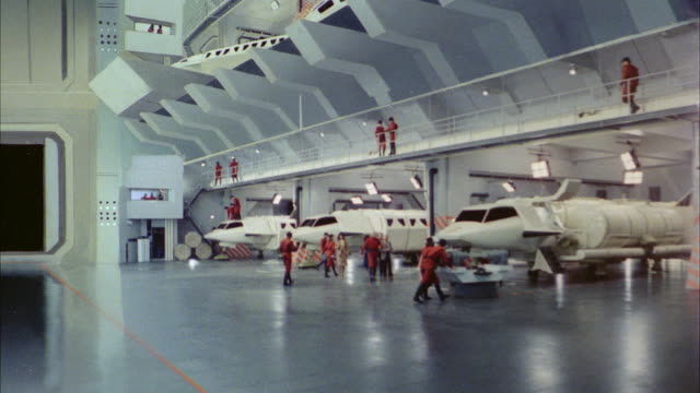 ms interior space ship with people walking  - airplane hangar stock videos & royalty-free footage