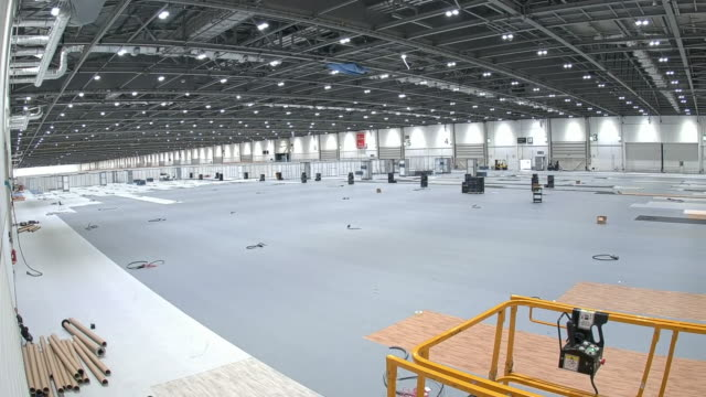 interior time-lapse of wards being built in the excel centre as it is re-purposed as an nhs nightingale field hospital on 31 march 2020 in london,... - time lapse stock videos & royalty-free footage