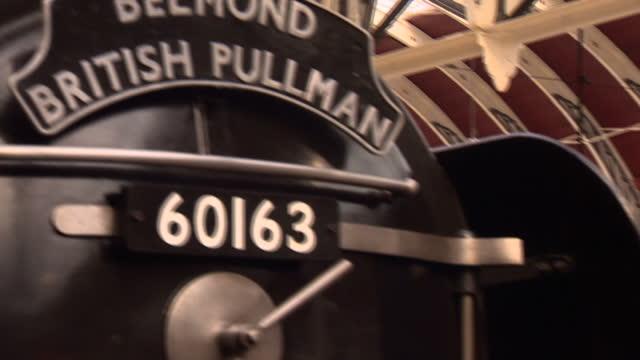 interior various shots green belmond british pullman 60163 steam train labelled tornado & british railways arriving into paddington station, train... - paddington railway station stock videos & royalty-free footage