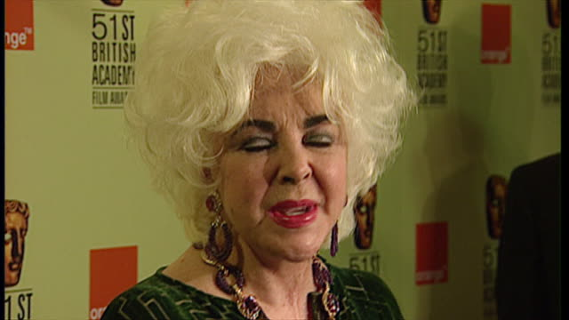 interior view of actress elizabeth taylor giving a press interview at the bafta film awards after recieving the fellowship award on 11 april 1999 in... - receiving stock videos & royalty-free footage