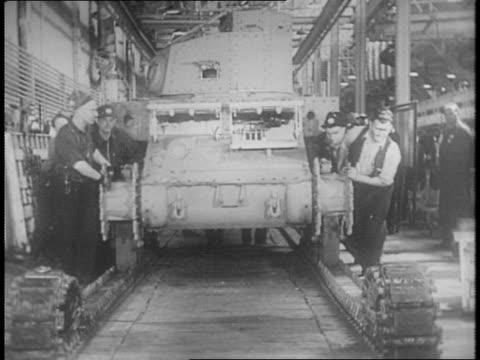 vídeos y material grabado en eventos de stock de interior view of berwick plant / interior shot of factory, showing tank production, manufacturing / workers on the factory floor / close up of man... - sparks