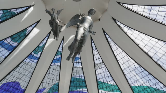 ms interior view of brasilia cathedral showing angel sculptures / catedral metropolitana / brasilia, brazil - oscar niemeyer stock videos and b-roll footage