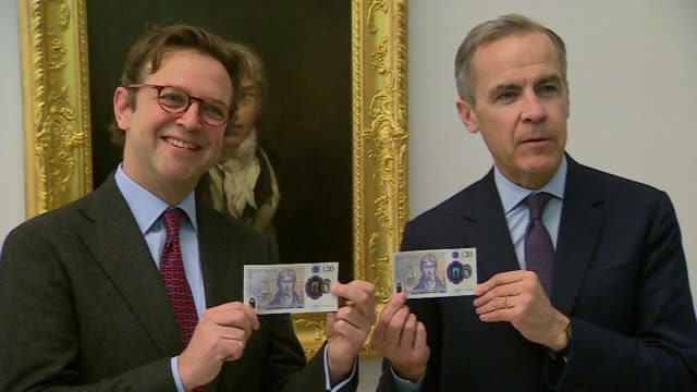 interior view of mark carney governor of the bank of england and alex farquharson director of tate britain showing off the new £20 pound note in... - british pound sterling note stock videos & royalty-free footage