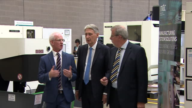 interior view of phillip hammond the chancellor as he enters the factory floor for a walkabout with managers and is introduced to staff at mct... - フィリップ ハモンド点の映像素材/bロール