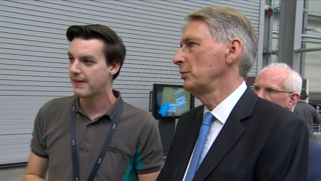 interior view of phillip hammond the chancellor as he is shown new technologies at mct manufacturing technology centre campus at ansty park on august... - フィリップ ハモンド点の映像素材/bロール