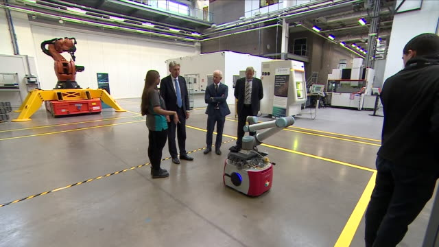 interior view of phillip hammond the chancellor as he talks with managers and is introduced to staff at mct manufacturing technology centre campus at... - フィリップ ハモンド点の映像素材/bロール