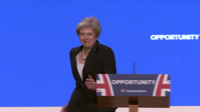 interior view of prime minister theresa may arriving on stage to deliver her keynote speech at the conservative party conference and dancing to the... - theresa may stock videos & royalty-free footage