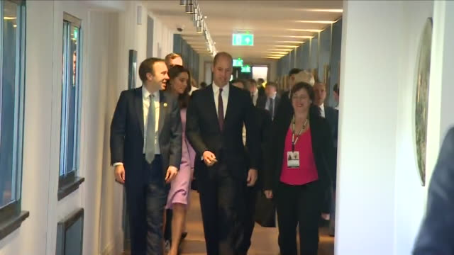 Interior view of the Duke and Duchess of Cambridge walking down a corridor with Matt Hancock Health Secretary at County Hall and meeting and greeting...