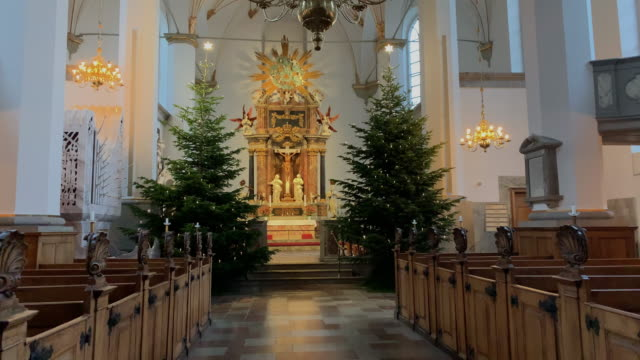 interior view of trinitatis church attached to the rundetaarn in copenhagen denmark on december 14 2018 decorated with christmas decorations - oresund region stock videos & royalty-free footage