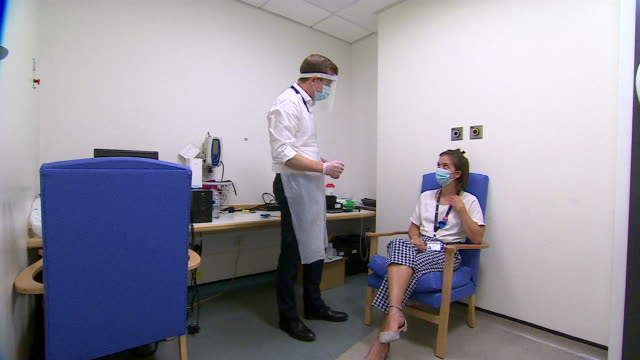interior views of a doctor taking a swab from a patient to be tested for covid-19 in the new rapid dnanudgebox test system in chelsea and westminster... - doctor stock videos & royalty-free footage