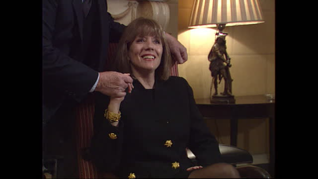 interior views of a photocall to promote the launch of the complete avengers vhs box set, showing diana rigg and patrick macnee posing for photos on... - diana rigg stock videos & royalty-free footage