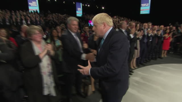interior views of boris johnson walking off stage after making his statement speech and being cheered and congratulated by members of the cabinet... - convention stock videos & royalty-free footage
