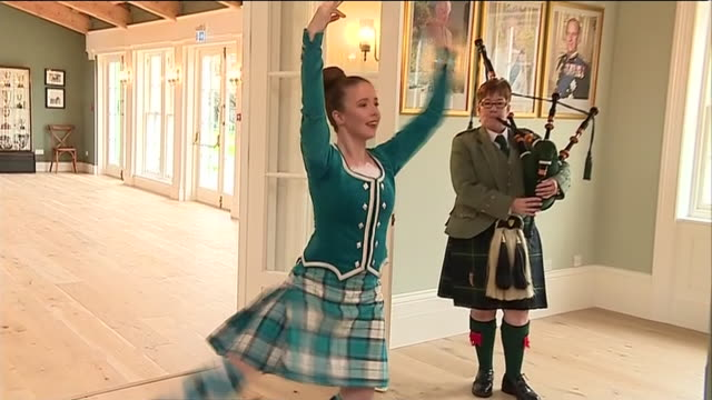 interior views of camilla duchess of cornwall watching a display of highland dancing by rachel walker at the new heritage centre named in honour of... - danza tradizionale video stock e b–roll