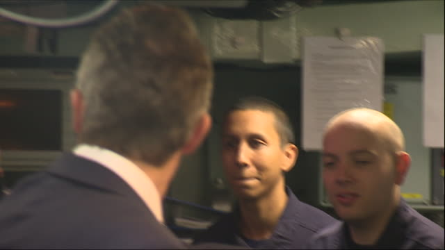 Interior views of Defence Secretary Gavin Williamson on board HMS Montrose and meeting and shaking hands with sailors and crew in the operations room...
