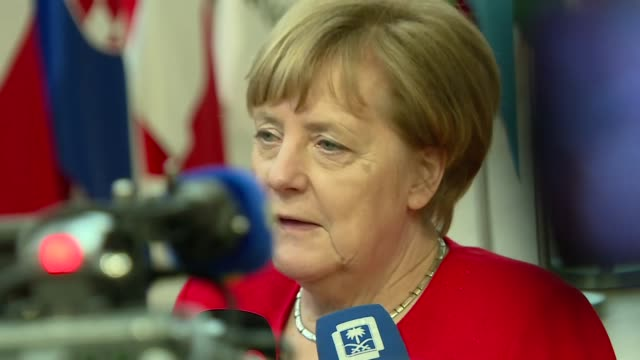 interior views of federal chancellor of germany angela merkel being interviewed by a media press scrum at the eu summit including change of focus on... - チャンセラー点の映像素材/bロール