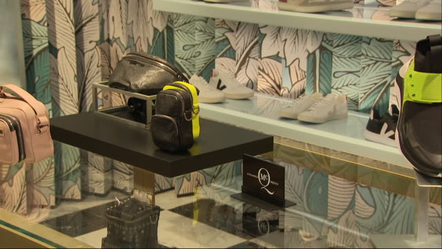 stockvideo's en b-roll-footage met interior views of high end designer shoes in a flannels store, part of the sports direct retail group, including moschiino shoes on 11 september... - merchandise