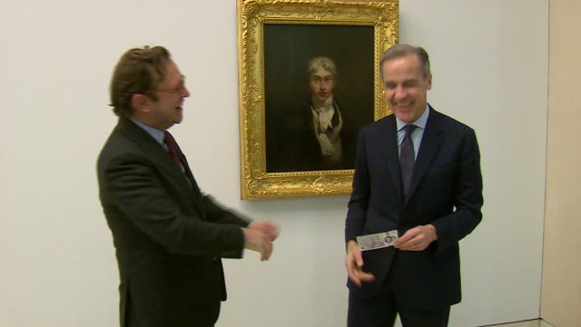 interior views of mark carney governor of the bank of england and alex farquharson director of tate britain showing off the new £20 pound note in... - british pound sterling note stock videos & royalty-free footage