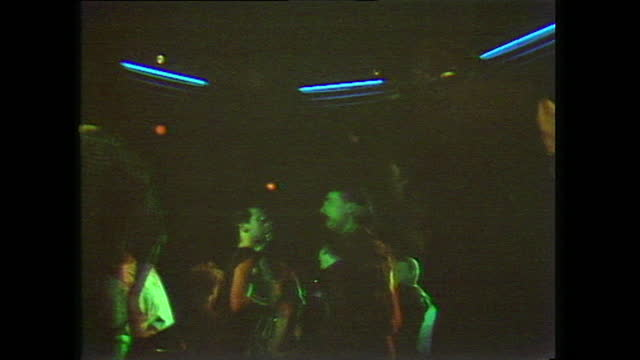 interior views of men and women dancing in an unspecified gay nightclub in the united kingdom; 1983. - low angle view stock videos & royalty-free footage