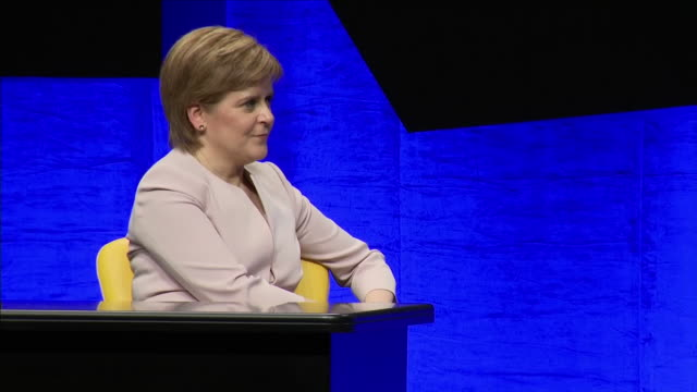 interior views of nicola sturgeon, the first minister of scotland and leader of the snp,, on stage listening to a snp speaker with other delegates at... - nicola sturgeon stock videos & royalty-free footage