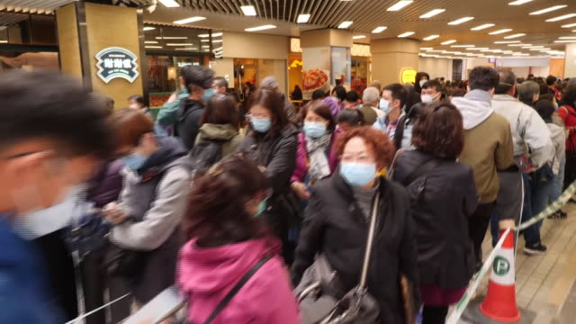 interior views of people queing to buy face masks to combat the spread of the coronavirus in hong kong china on 30 january 2020 - coronavirus stock videos & royalty-free footage