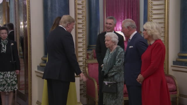 interior views of president trump and first lady melania being introduced to the queen, prince charles and the duchess of cornwall at the reception... - nato stock videos & royalty-free footage