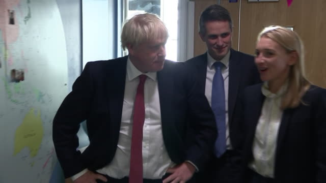 interior views of prime minister boris johnson and gavin williamson, the minister for education, arriving at pimlico primary school and being greeted... - head teacher stock videos & royalty-free footage