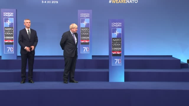 interior views of prime minister boris johnson and nato general secretary jens stoltenberg greeting german chancellor angela merkel on the podium at... - chancellor of germany stock videos & royalty-free footage