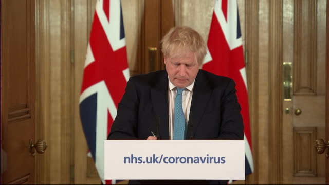 interior views of prime minister boris johnson giving his daily coronavirus press conference and taking a question from beth rigby of sky news about... - press conference stock videos & royalty-free footage