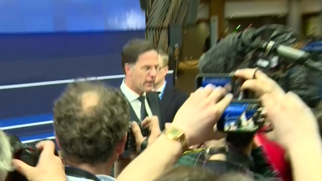 interior views of prime minister of the netherlands mark rutte being interviewed by a media press scrum at the eu summit 21 march 2019 in brussels... - スクラム点の映像素材/bロール
