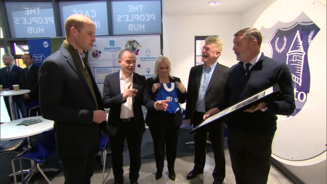interior views of prince william being presented with gifts including an everton shirt at the everton in the community project in liverpool united... - shirt stock videos & royalty-free footage