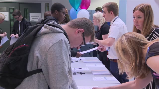 interior views of students receiving their gcse results on 23rd august 2018 at the wmg academy for young engineers in coventry, united kingdom. - 一般教育証明試験点の映像素材/bロール
