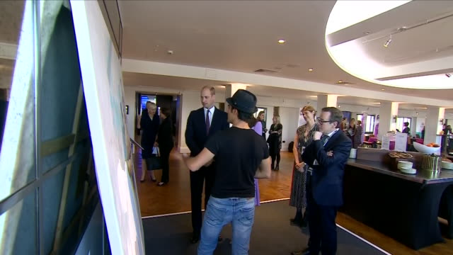 Interior views of the Duke and Duchess of Cambridge talking to Dairo Vargas a contemporary fine artist from Columbia and they both have a try at...