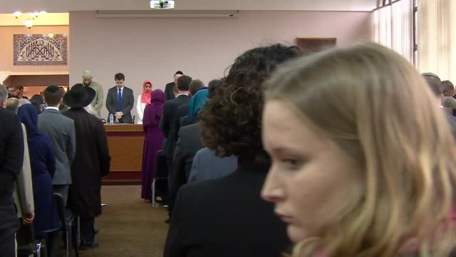 interior views of the guest speakers and audience as they pay tribute with a perioid of silence at the interfaith meeting to remember the victims of... - ジャスティン・ウェルビー点の映像素材/bロール