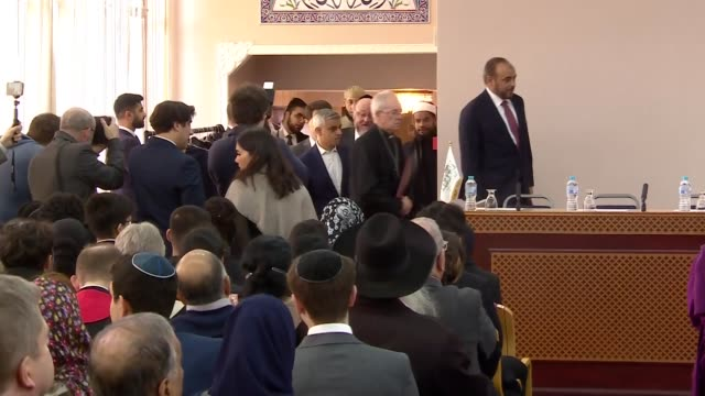 interior views of the guest speakers entering the hall and are welcomed to a table at the front of the hall from left imam mohammed mahmoud... - ジャスティン・ウェルビー点の映像素材/bロール