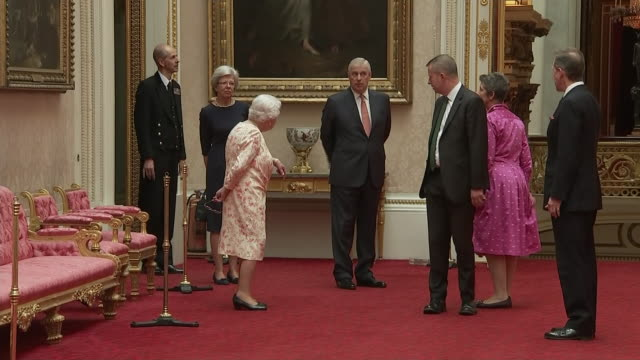 interior views of the queen being introduced to lucy peter asistant curator of the queen victoria exhibition at buckingham palace on 17 july 2019 in... - buckingham palace stock videos & royalty-free footage