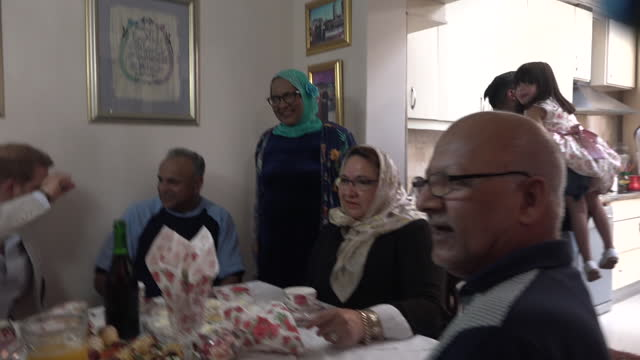 interior views of the the duke and duchess of sussex having tea and cake with residents of the historic bo- kaap neighbourhood, including osman... - chairperson stock videos & royalty-free footage