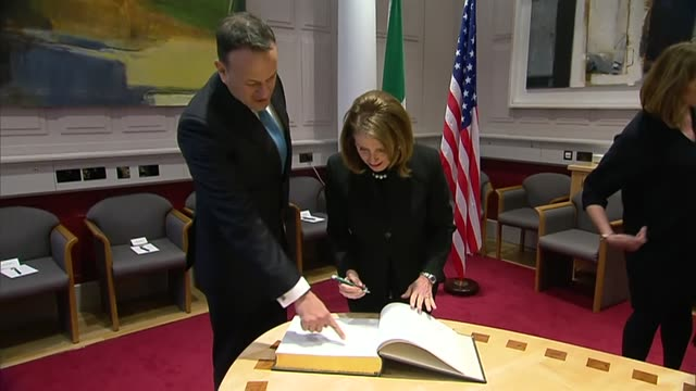 interior views of us speaker nancy pelosi and richie neal signing the guestbook at government buildings while leo varadkar watches on 16 april 2019... - leo varadkar stock videos and b-roll footage
